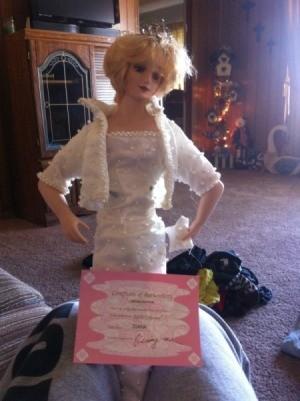 Diana doll wearing a white dress.