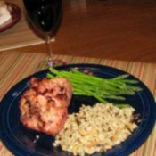 glazed chicken with asparagus and rice on plate.