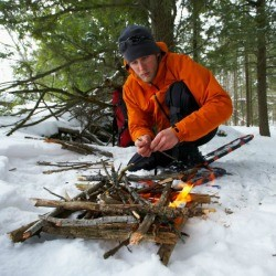 Man Building Fire in the Forest