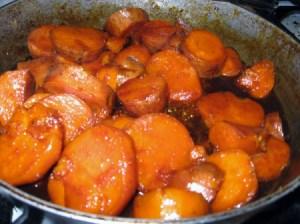 Sliced potatoes in skillet.