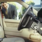 Man Looking Keys Locked in Car