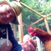 Ginger with owner who is holding an egg.