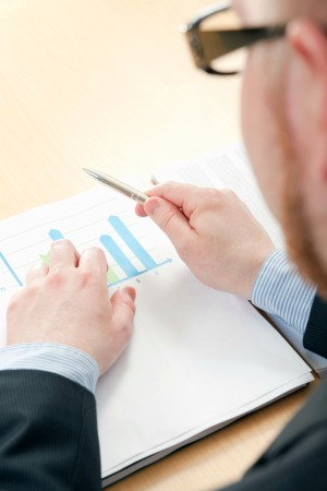 Man Writing a Business Proposal