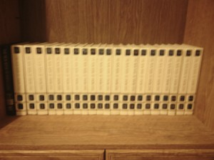 Set of encyclopedias on top of cabinet.