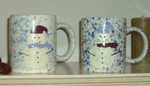 Snowman painted coffee mugs.