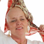 Chemo Patient Putting on Scarf