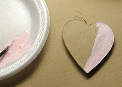 Painting heart pink.