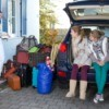 Loading the car for a family vacation.