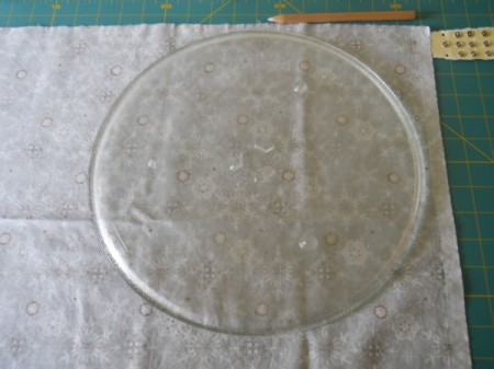 Microwave plate on wrong side of fabric.