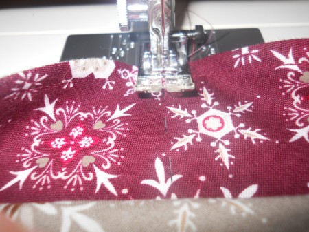Sewing the 2.25 inch lines through layer two and three.