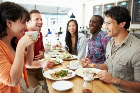 Adults at Luncheon Enjoying Tea Together