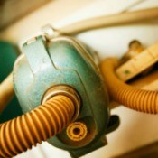 Old Vacuum Cleaner and Hose