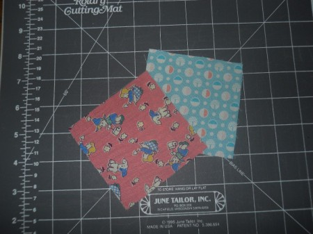 Two fabric squares.