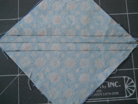 Square marked with dividing line and both seam lines.