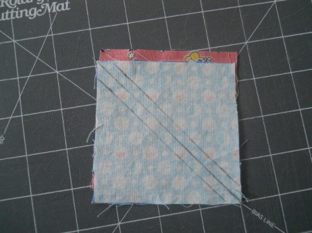 Squares with right sides together and marked side up.