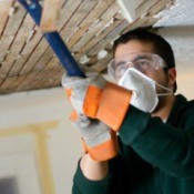 Man Remodeling a Basement