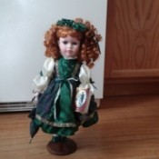 Geppeddo Doll in green outfit.