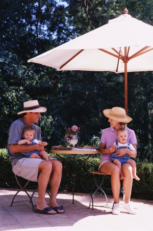 Family Under Patio Umbrella