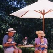 Family Under Patio Umbrella