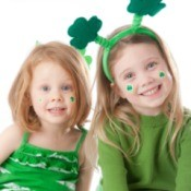 Girls in Green with shamrocks on their face.