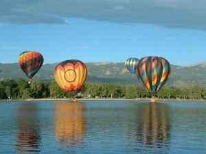 hot air balloons on water