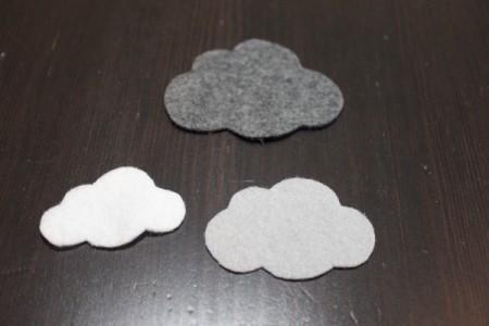 three felt clouds