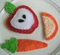 Apple half, carrot, and orange slice.