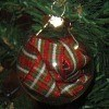 A glass ornament with ribbon inside.