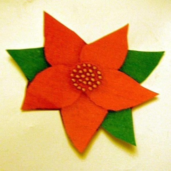 A completed poinsettia pin.