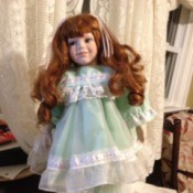 Red haired doll in frilly dress.