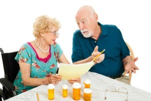 Elderly Couple Paying Medical Bills