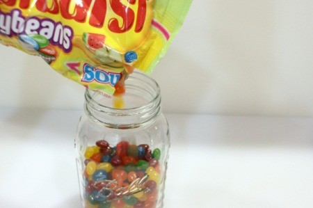 adding jellybeans to mason jar