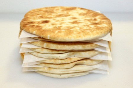 stack of pita bread with papers