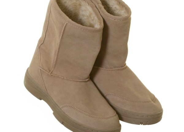 A Pair Of Tan Suede Boots
