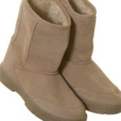 A pair of tan suede boots.