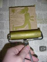 Applying ink to block.