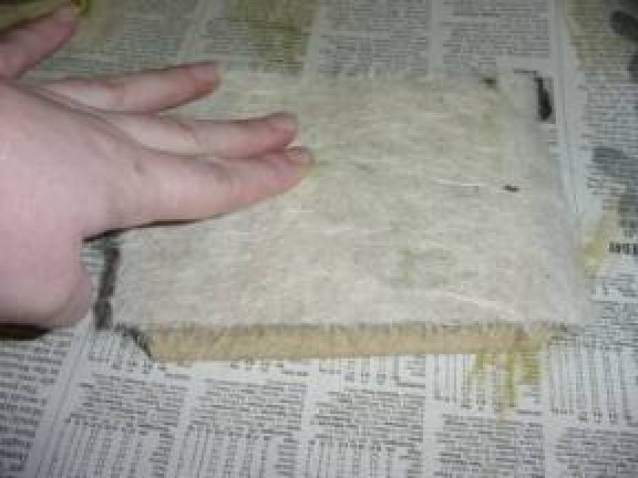 Removing printed paper from block.