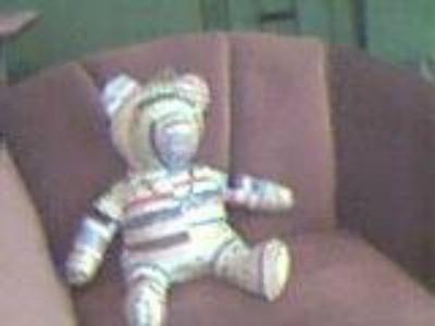 Bear on easy chair.
