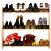 Shoes that are oranized on a shelf.