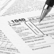 Filling out a tax form.