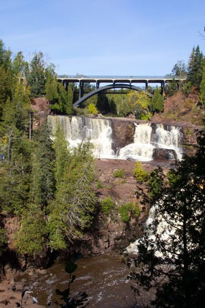 Waterfall under bridge.