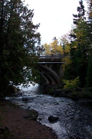 Stream running under a bridge.