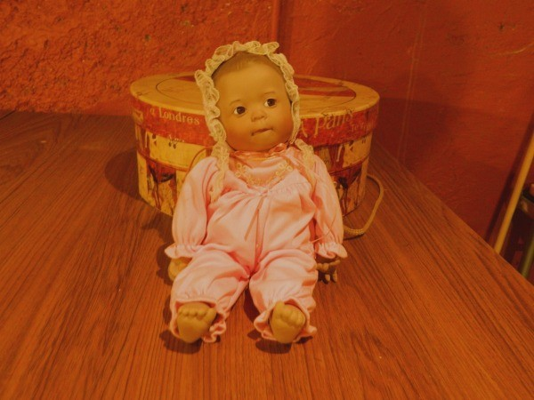 Baby doll with bonnet.