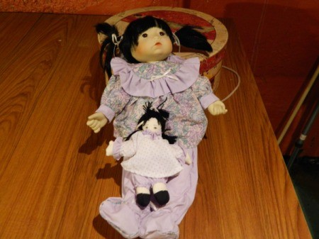 Doll with her own doll.