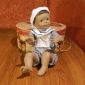 Boy doll with striped sailer style shirt.