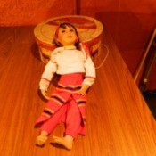 Doll with fitted pants and wrap skirt.