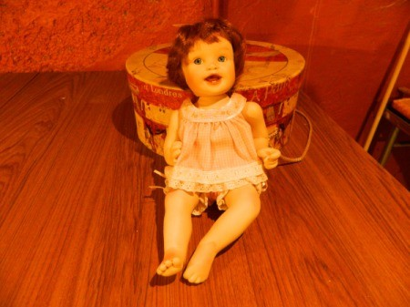 Doll with sleeveless baby doll shirt and bubble pants.