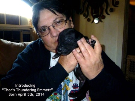 Lady holding puppy.