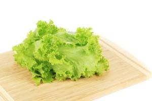 Lettuce on a cutting board.