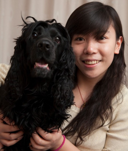 Teen girl with a black dog.